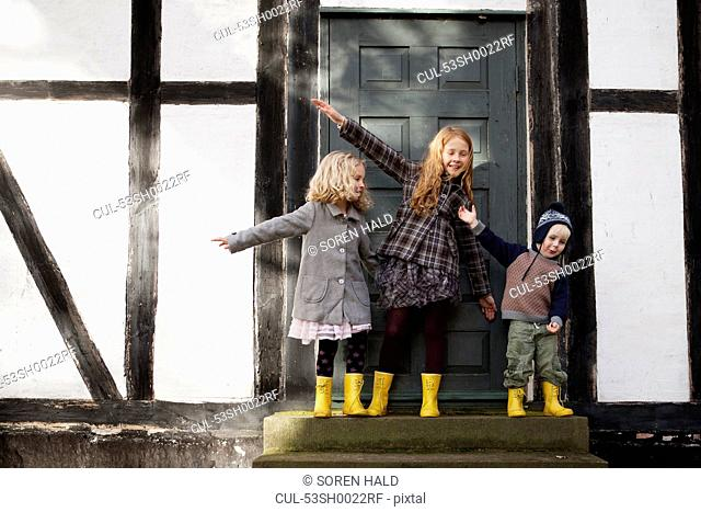 Children playing together on doorstep