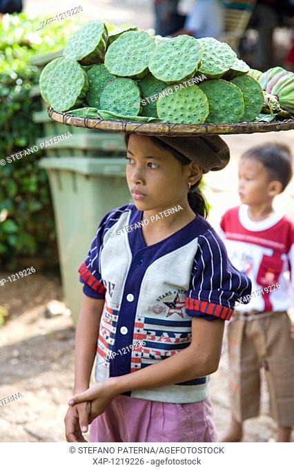Khmer girl selling lotus flower seeds. Phnom Penh, Cambodia