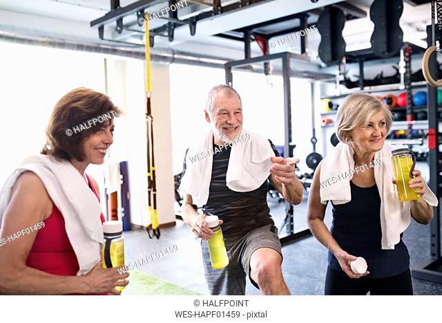 Group of fit seniors in gym taking a break