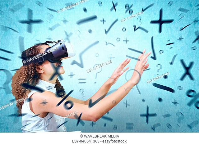 Composite image of young woman looking through virtual reality simulator while sitting on chair