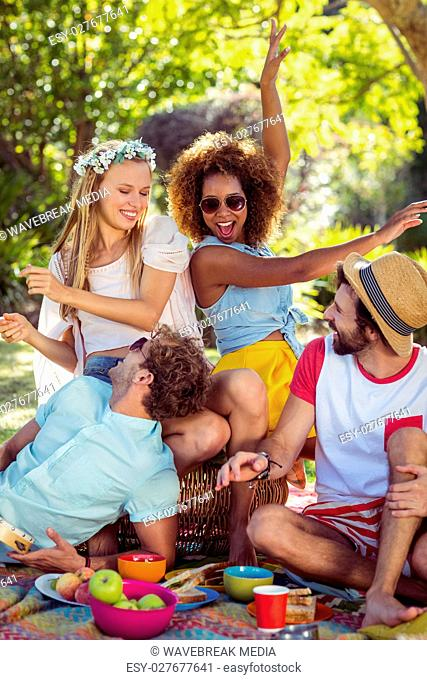 Group of friends having fun together in park