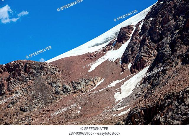 Snow slope of red mountain. Tien Shan, Kyrgyzstan