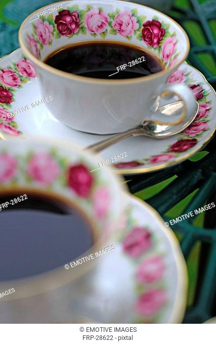 Two cups of coffee on garden table