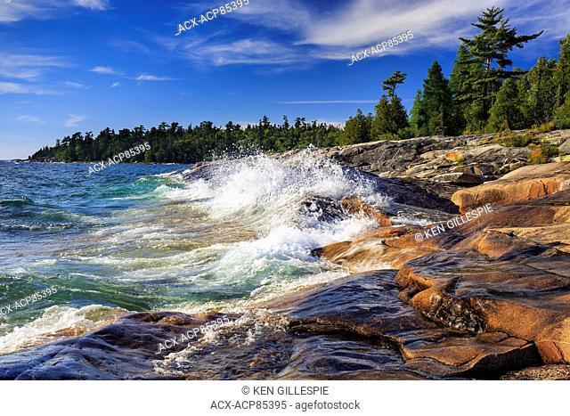 Waves crashing on rocks on Lake Superior at Catherine Cove, Lake Superior Provincial Park, Ontario, Canada
