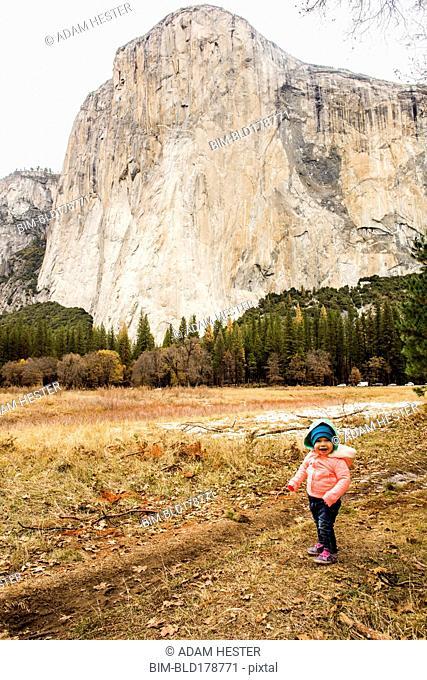 Caucasian baby girl walking in Yosemite National Park, California, United States