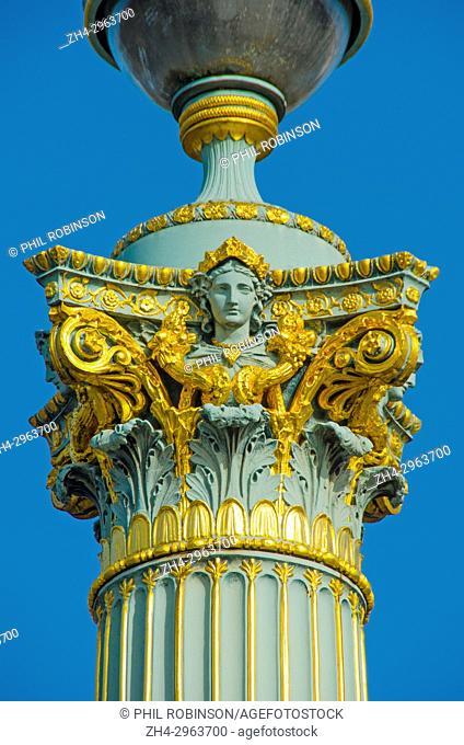 Paris, France. Place de la Concorde - detail of ornate streetlamp (A Muel, Fonderies de Tusey, 1857) Colonne Rostrale / Colonne Duilienne