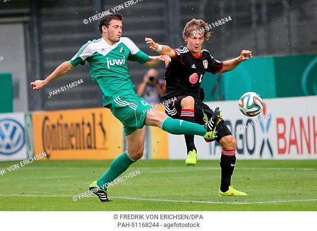 Waldagesheim's Christian Kloeckner (L)and Leverkusen's Tin Jedvaj in action during the first round DFB Cup match betweenAlemannia Waldalgesheim and Bayer...