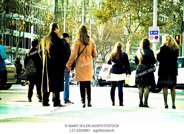 People waiting at a stoplight. Barcelona, Catalonia, Spain
