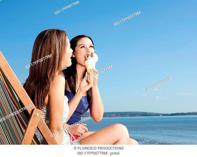 Girlfriends sharing ice-cream