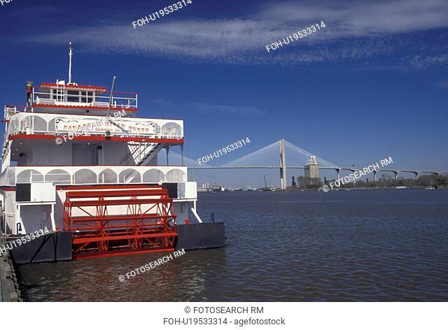 riverboat, Savannah, GA, Georgia, Savannah River Queen Riverboat docked along the Savannah River. Talmadge Memorial Bridge crossingthe Savannah River in the...