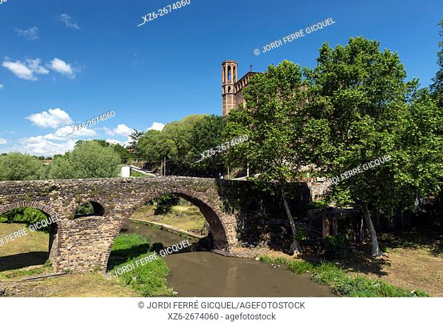 The medieval bridge and the church in Sant Joan les Fonts, Catalonia, Spain, Europe