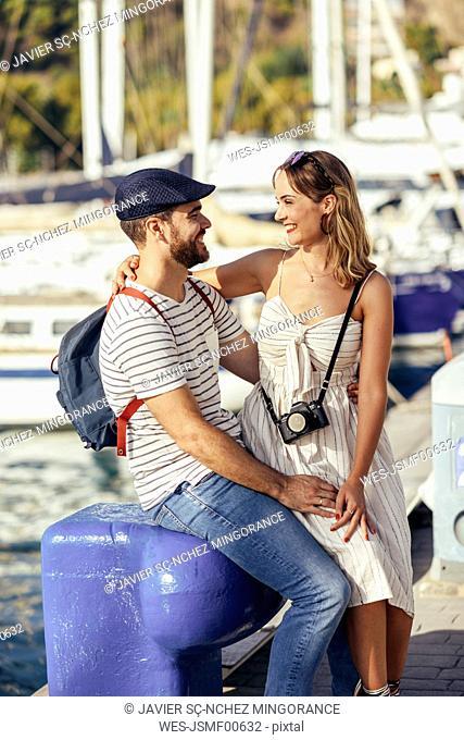 Spain, Andalusia, Malaga, happy tourist couple taking a break at the harbor