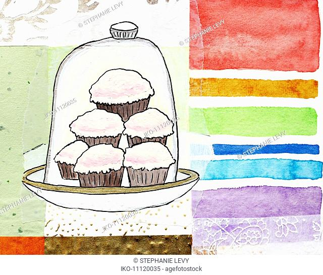 Cupcakes stacked under cake dome