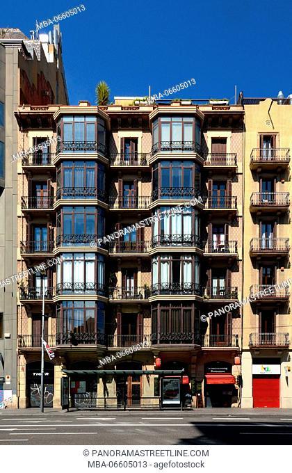 Barcelona, Catalonia, Spain. Building architecture at the Ronda de la Universitat in the district of Eixample in the Catalan capital