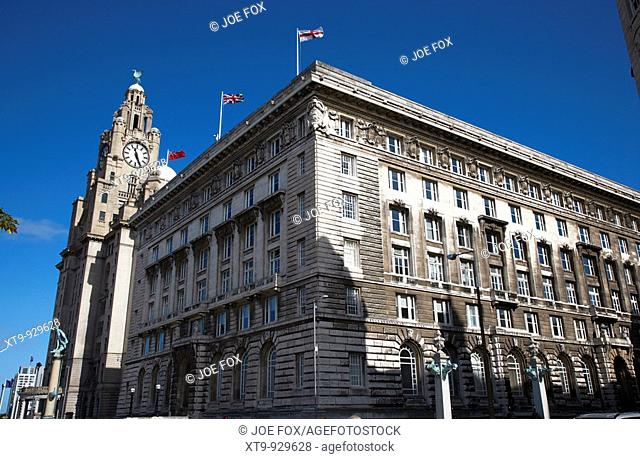 The Cunard Building with the liver building in the background one of liverpools three graces listed buildings on the liverpool waterfront at pier head...