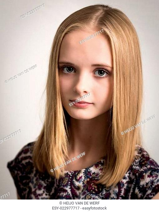 Beautiful Young Blond Teenage Girl in Flower Top