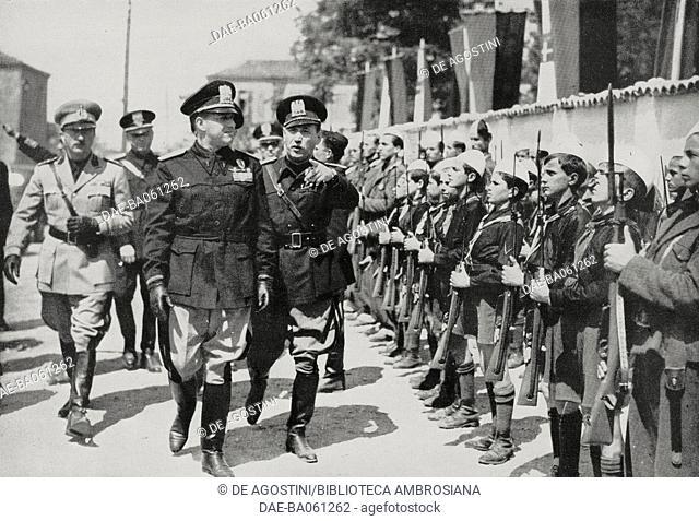 Galeazzo Ciano inspecting the youth formations in Tirana, Albania, from L'Illustrazione Italiana, 1940. DeA / Veneranda Biblioteca Ambrosiana, Milan