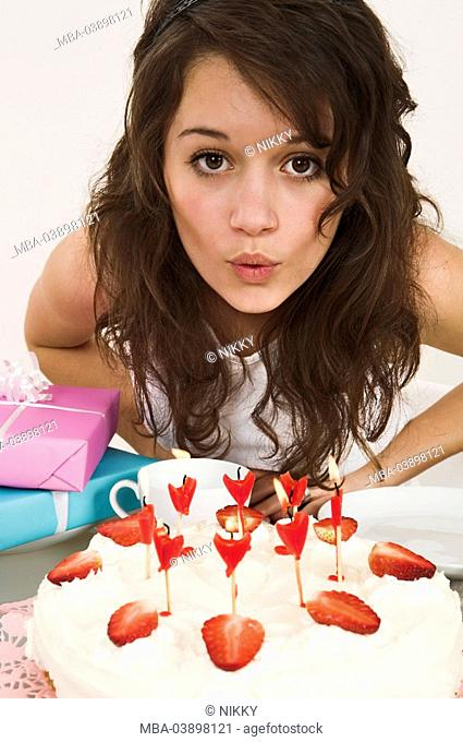 girl, pie, candles, blows out, gifts, semi-portrait, table, people, teenagers, teenager-girl, cream-pie, strawberry-pie, birthday-pie, cakes, decorates