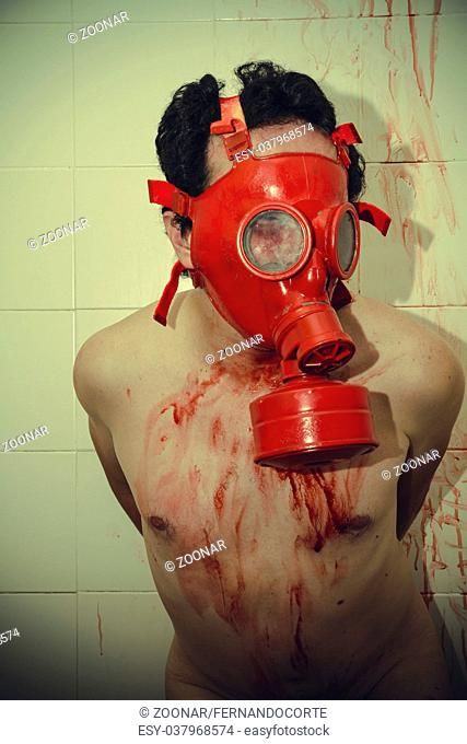fear man with red gas mask, blood, despair and suicide