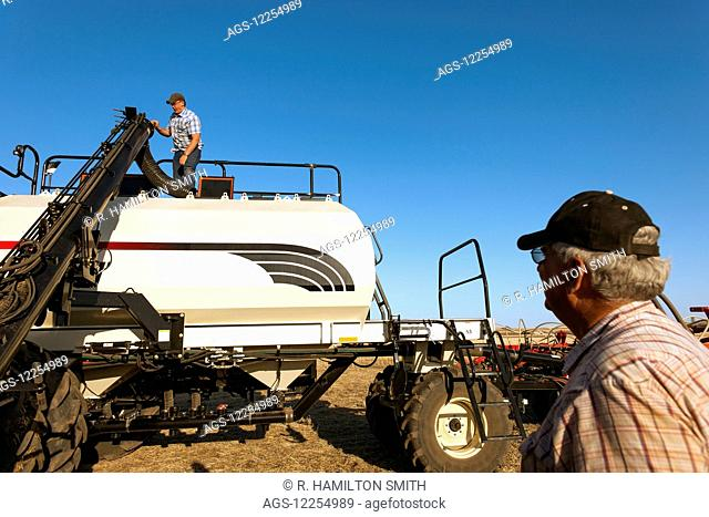 Farmers with heavy farm machinery ready to plant lentils in Williams County, near Ray; North Dakota, United States of America