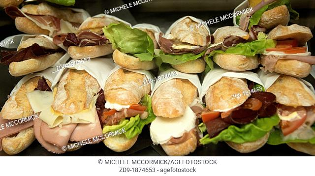 An array of tempting sandwiches on display in the window of a cafe in Milano