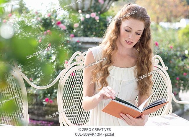 Young woman looking at a book