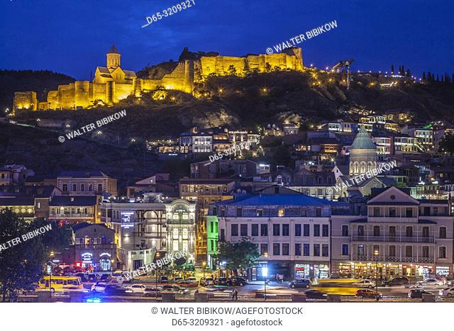 Georgia, Tbilisi, Old Town, high angle view with Narikala Fortrress, evening