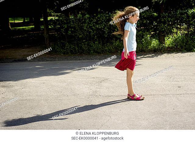 Italy, Girl (10-12) enjoying blowing wind