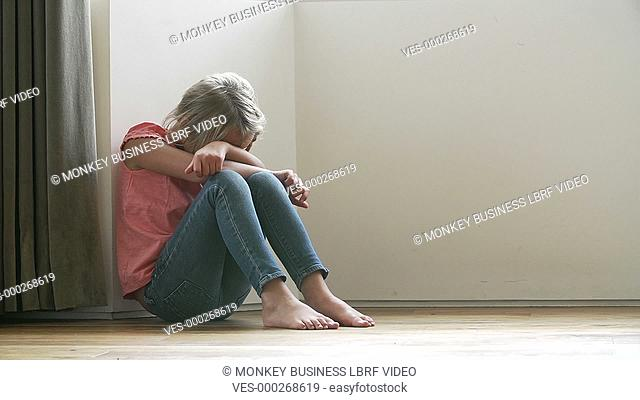 Mother shouts at upset young daughter who is sitting on floor crying.Shot on Sony FS700 in PAL format at a frame rate of 25fps