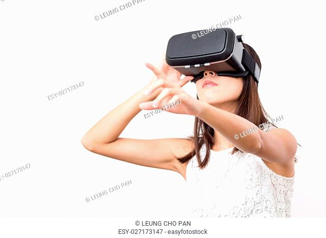 Young woman watching though virtual reality device