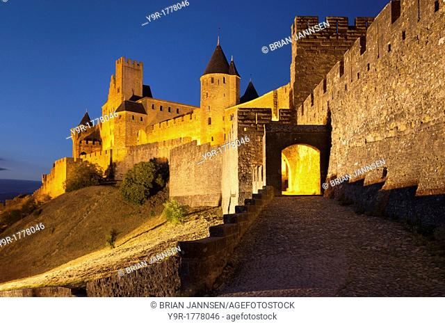 Twilight at the entry gate to La Cite Carcassonne, Languedoc-Roussillon, France