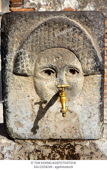 Water fountain on a street in the ancient Roman city of Pompeii
