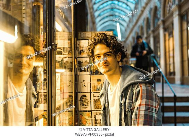 Portrait of smiling young man in shopping centre