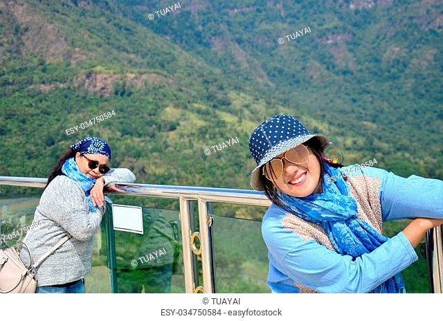 Thai woman and old women travel and portrait with view of Khao Kho mountain near Wat Pha Sorn Kaew at Khao Kor, Phetchabun, in north-central Thailand