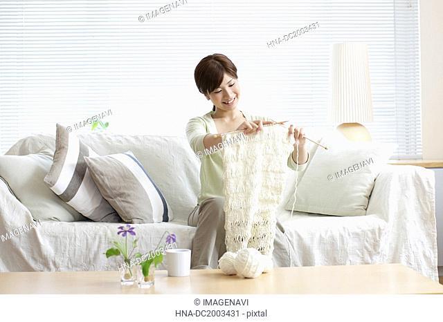 Woman on Sofa Knitting