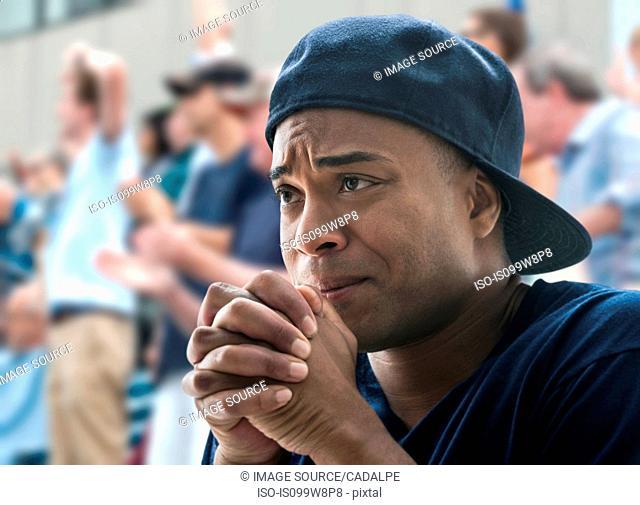 Tense man at sports game