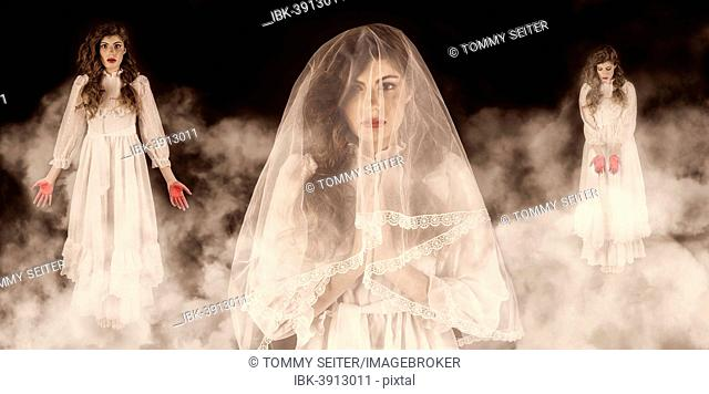 Girls with veils, white dresses and red hands, surrounded by smoke