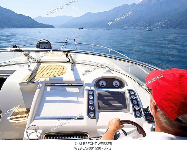 Switzerland, Ticino, Lago Maggiore, senior man on boat
