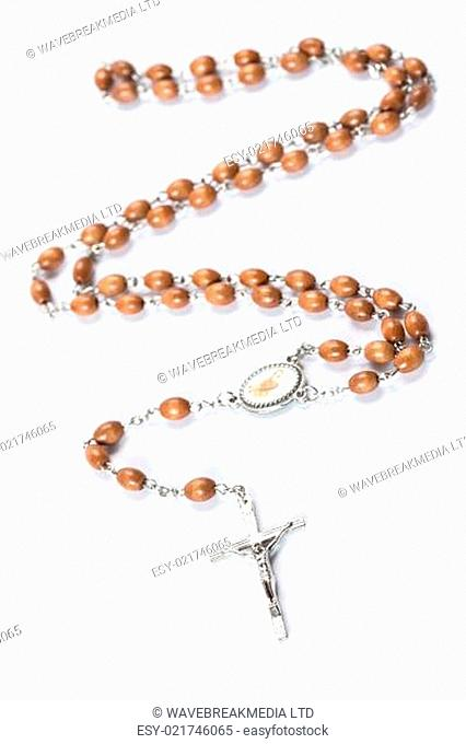 Wooden and silver rosary beads on white background