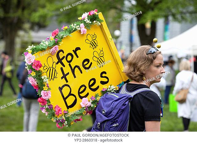Seattle, Washington: Woman in a bee costume holds a protest sign at the rally in Cal Anderson Park. The March for Science Seattle was a non-partisan rally and...