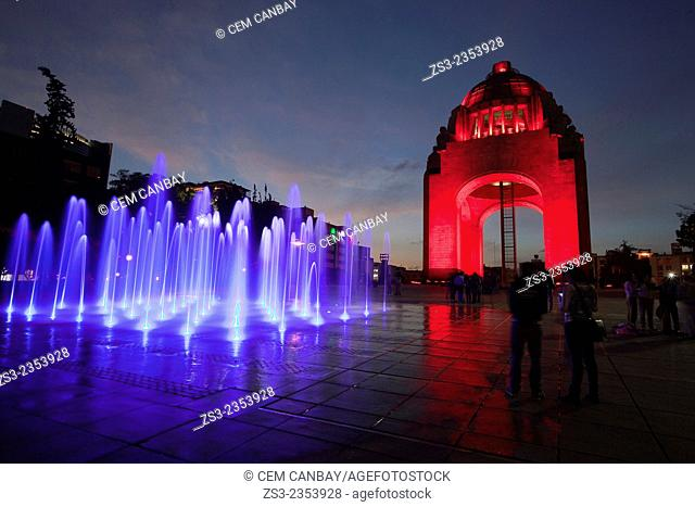 Monument dedicated to the Mexican Revolution (Monumento dedicado a la Revoluci—n Mexicana) with colorful water show and silhouettes of people at night