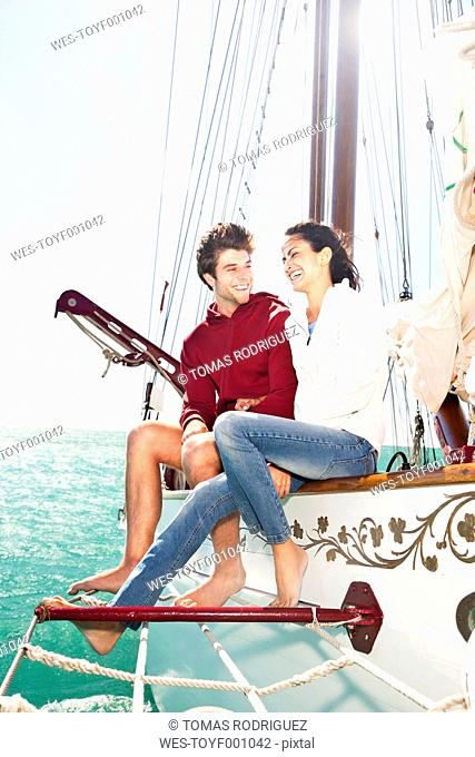 Happy young couple on a sailing ship