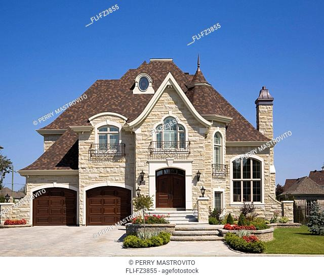 Luxurious Home with two car garage, landscaped front yard and paving stone driveway, Blainville, Quebec