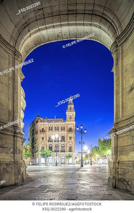 The Telefonica Building (design by Juan Talavera Heredia, 1926), framed by the City Hall Arquillo (arch, 16th century), Seville, Spain