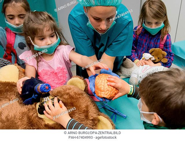 Medical student Sophie Breuer performing surgery on a teddy at the teddy hospital at the Clinic and Policlinic for Children and Youth Medical Science of the...