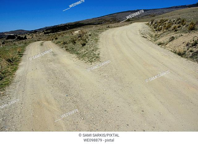 Dirt road forks into two in the Alpujarras mountains, Andalusia, Spain