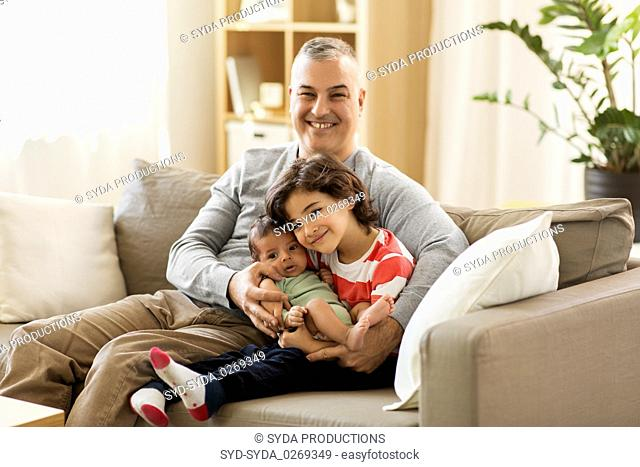 happy father with preteen and baby son at home