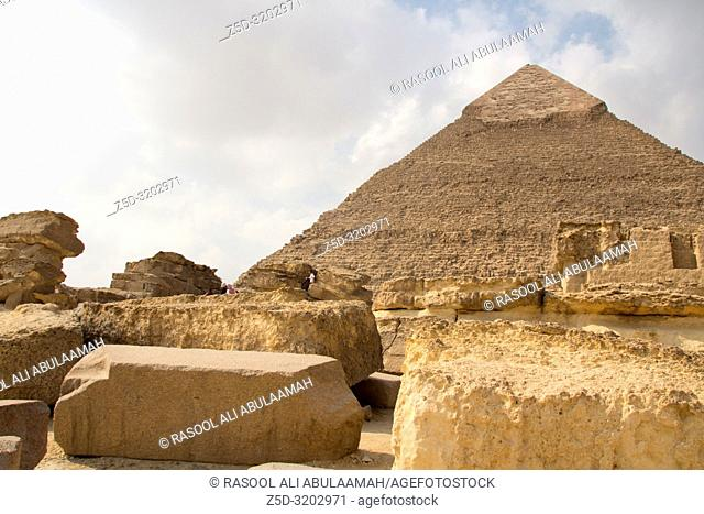 Cairo, Egypt – November 12, 2018: photo for Pyramid of Khufu in the Pyramids of Giza in Cairo city capital of Egypt. And some archeological buildings