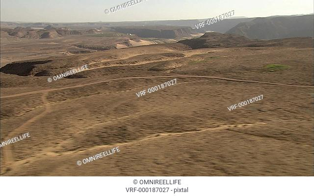 Hills and roads in desert landscape