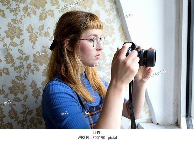 Female student using camera